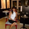 """Fabiola Cristina sitting in Gallery Prior to Opening of Exhibit. Joseph Cristina's Fine Art Photography """"Angelic Droplets"""" Series just over her shoulder"""